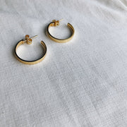 gold open hoop earring lines and current