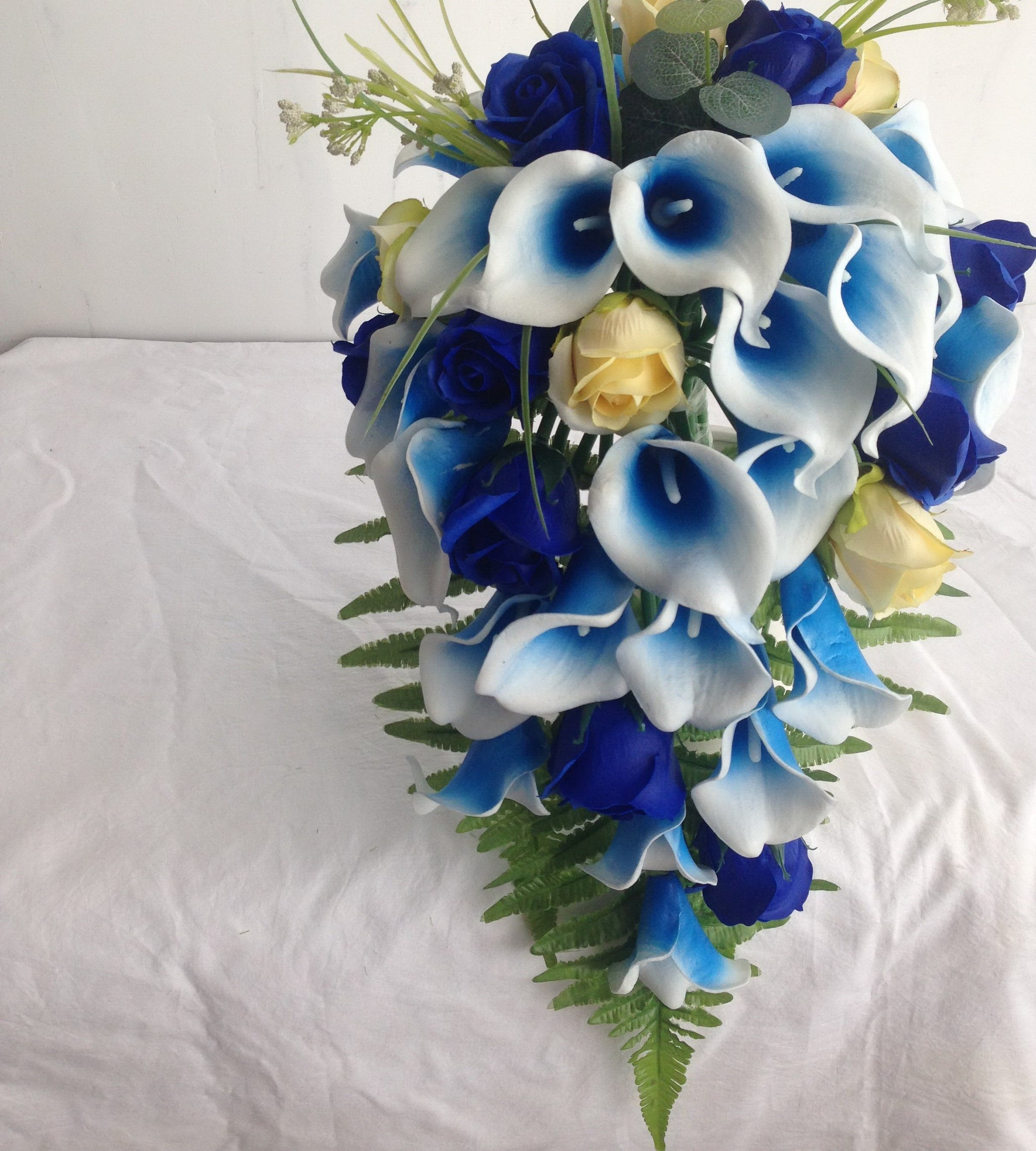 royal blue wedding centerpieces cascade bouquet boutonniere