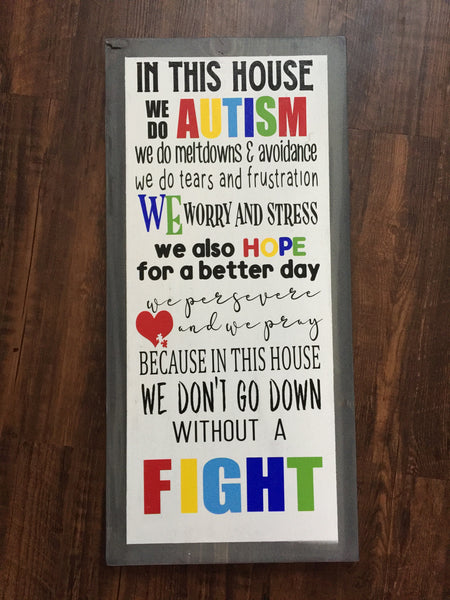 IN THIS HOUSE WE DO AUTISM WOOD SIGN