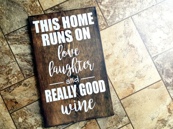 THIS HOUSE RUNS ON LOVE LAUGHTER AND REALLY GOOD WINE