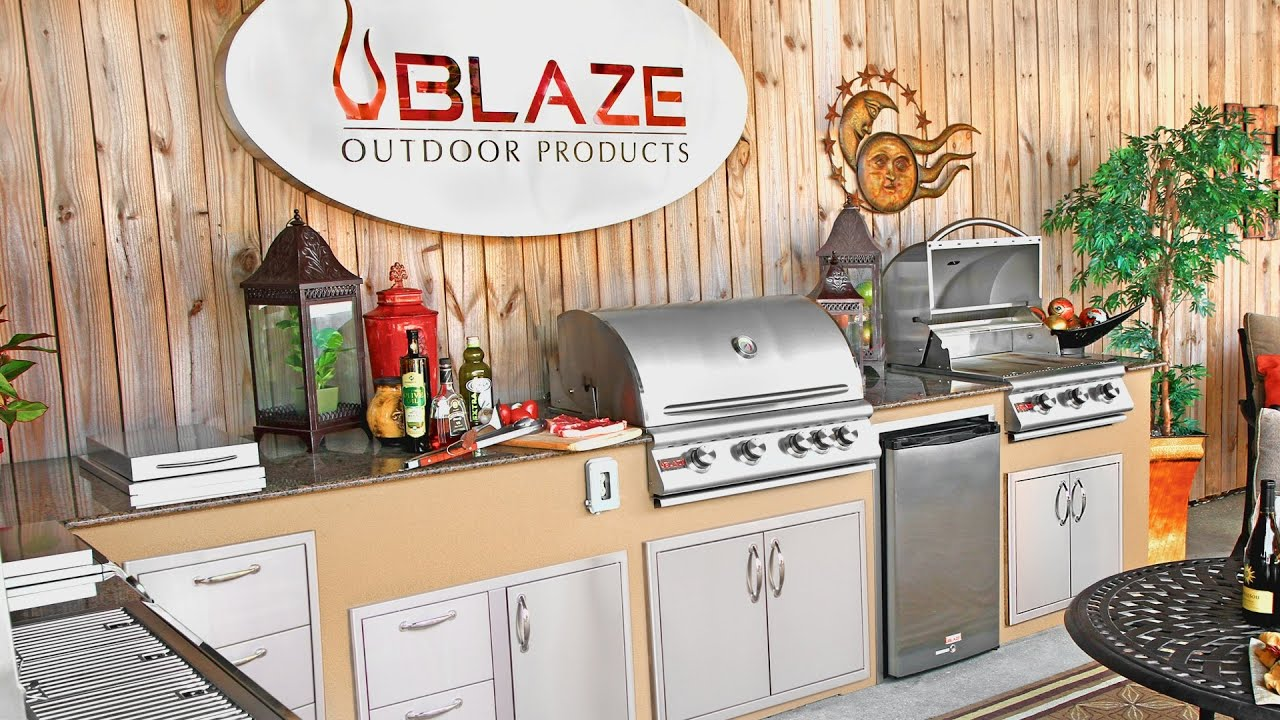 Outdoor Kitchen with Blaze grills, side burners and refridgerator