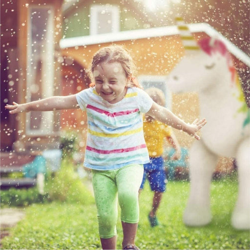 Little girl playing in aHumongous Unicorn Sprinkler