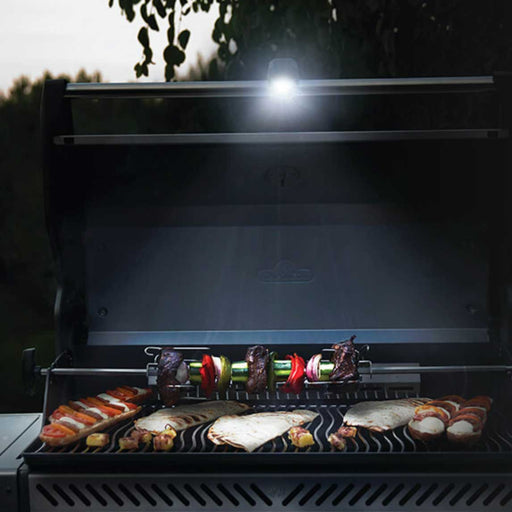 Handle-Mounted Grill Light on top of grill lighting up food