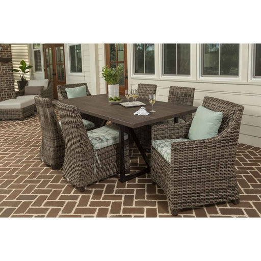 Woven outdoor dining set with mint green cushions