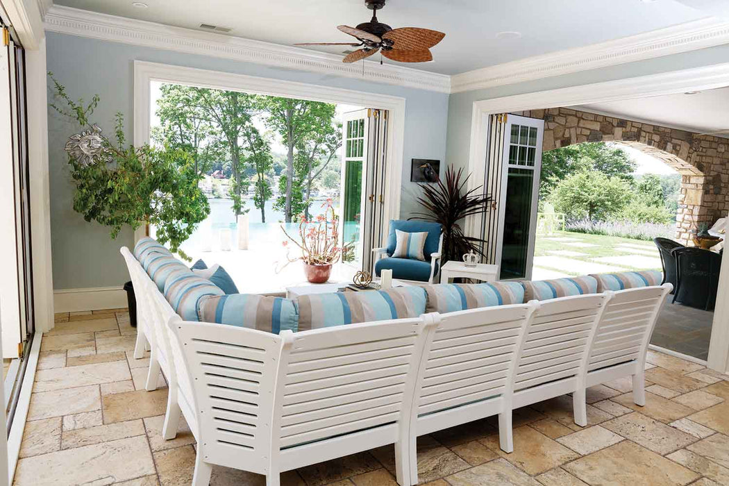 back view of White poly lumber outdoor L-shaped sectional sofa set  under a covered patio