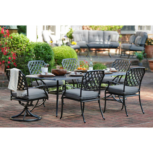 "Madison 72"" Alumicast Outdoor Dining Set on a brick patio"