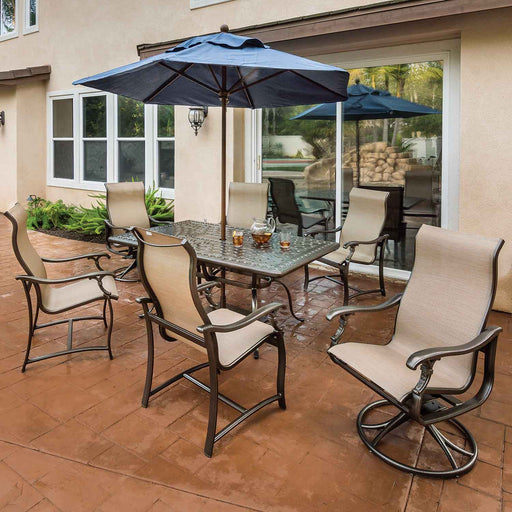 Ravello Sling Outdoor Dining Set with blue umbrella