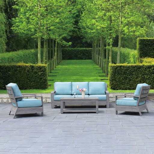 Seattle Sofa set on a cobble stone patio surrounded by trees