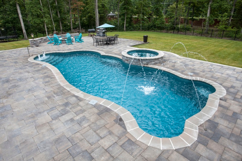 Synergy Modern Freeform Fiberglass Pool with Pavers, Fire Pit, Deck Jet & built in Spa