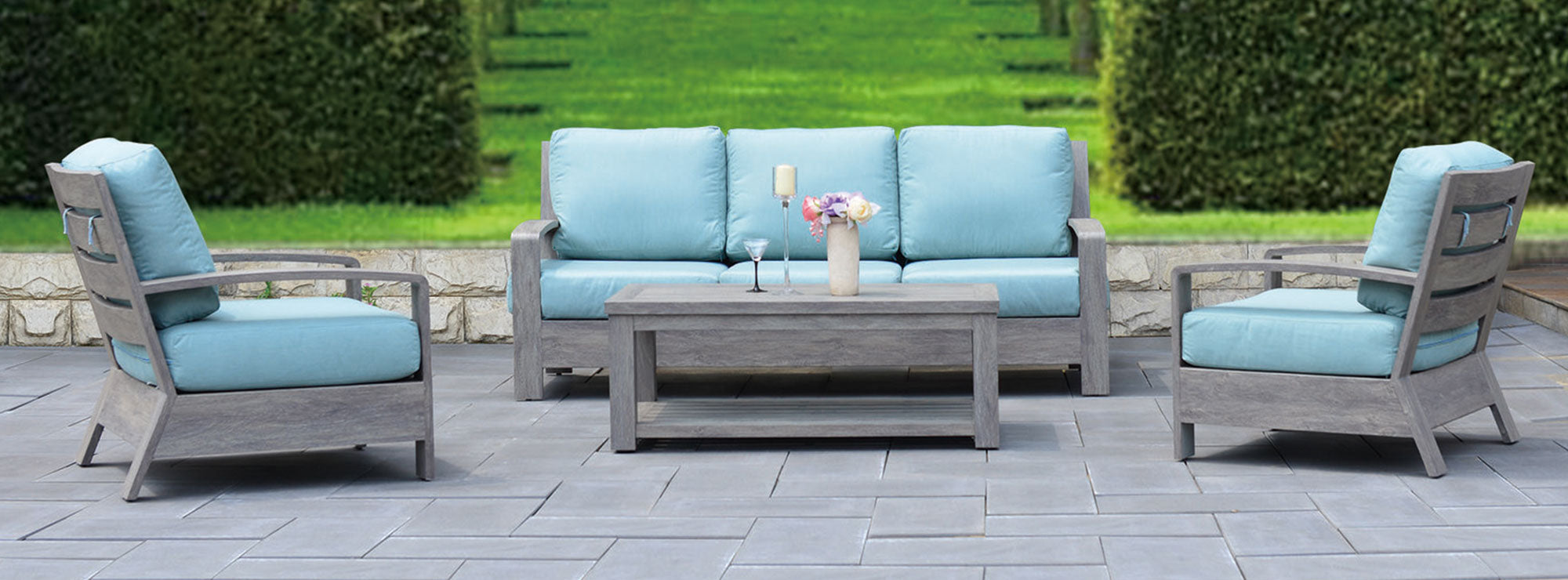 seattle outdoor sofa with grey frame and blue cushions