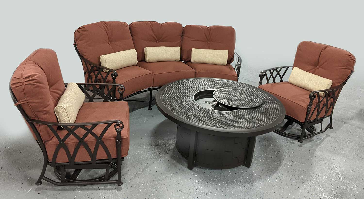 curved outdoor burnt orange sofa set and round fire pit