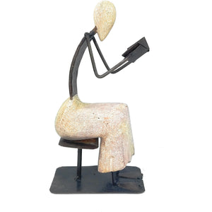 Recycled Metal and Stone Person Reading