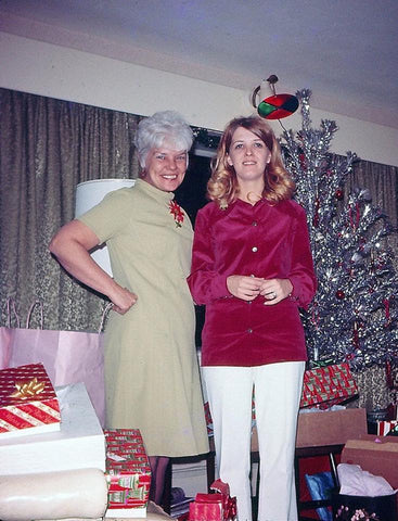 Mother and daughter with vintage Christmas tree