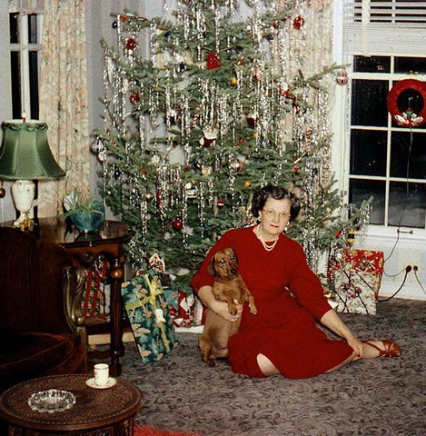 Vintage woman and dog with Christmas tree