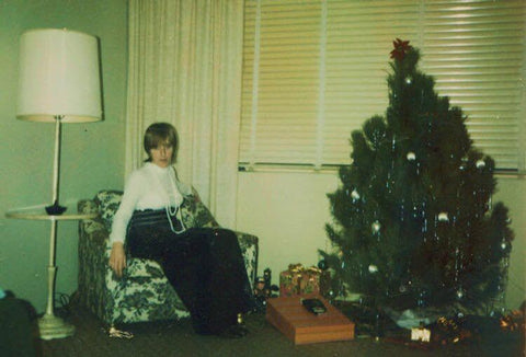 1970s woman with Christmas tree