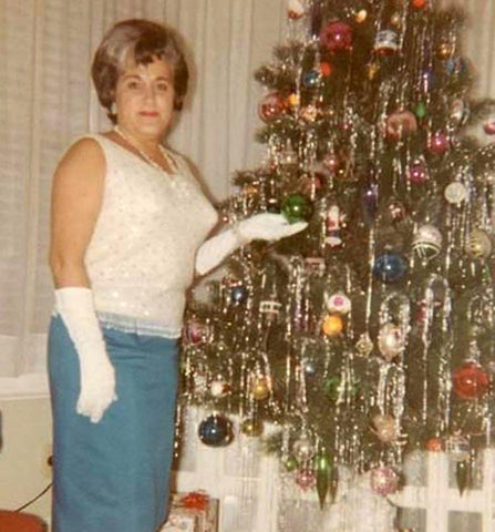 Woman stood with vintage Christmas tree