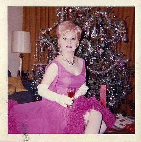 Woman in pink with vintage Christmas tree