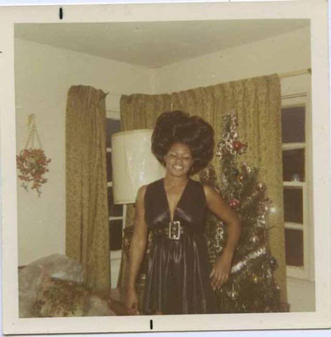 Black woman with vintage Christmas tree