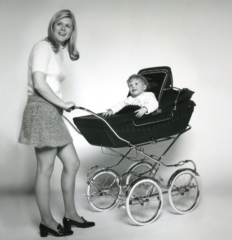 1970s mother with baby in pram