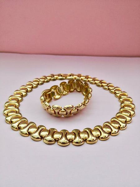 side view of gold necklace and bracelet set