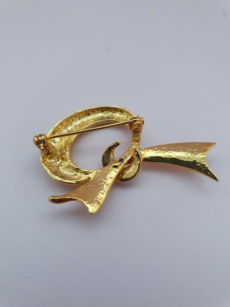 VINTAGE LARGE GOLD AND DIAMANTE BOW SHAPE BROOCH