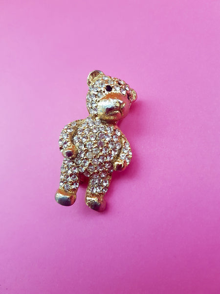 close up gold and diamante teddy brooch