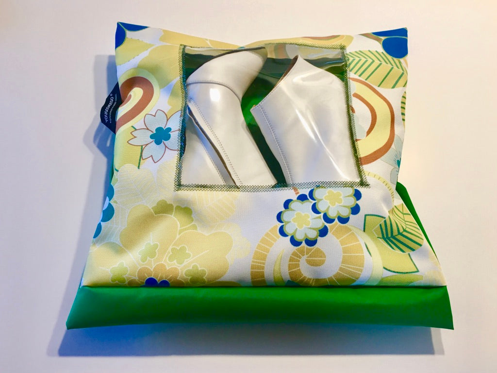 Patterned shoe pouch with a square window.
