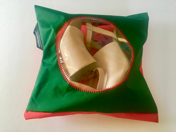 dark green and orange protective shoe pouch with circular window.