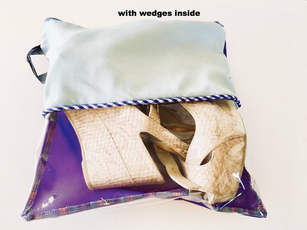 This pouch is pale blue and purple with a horizontal transparent window.