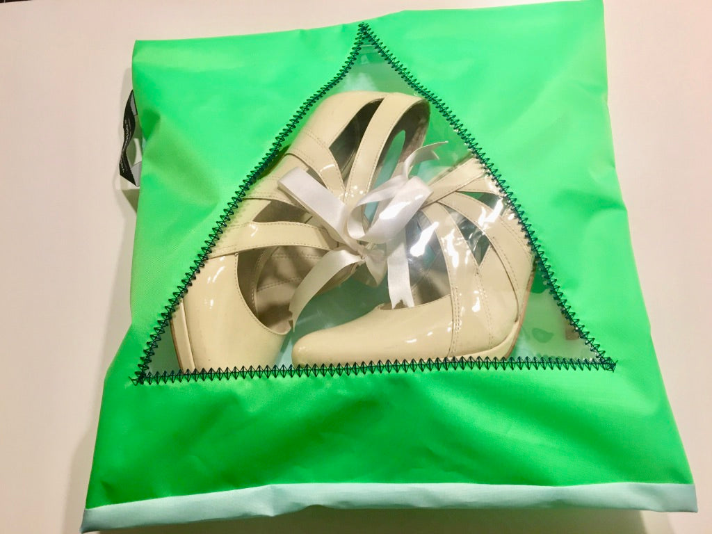 Bright green shoe pouch with transparent triangular window and useful hanging loop