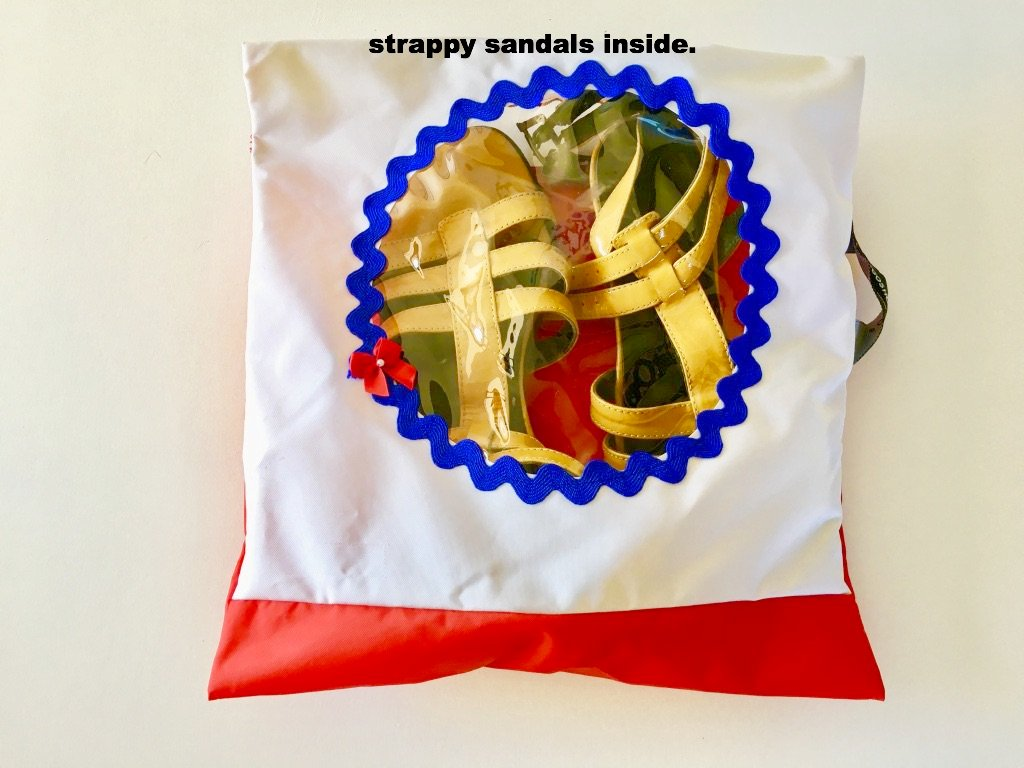 Lovely shoe pouch in white and red with a transparent circular window.