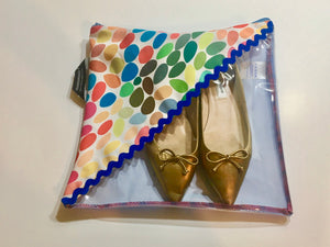 Patterned shoe pouch with a diagonal window