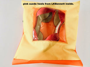 Pretty shoe pouch in yellow and orange with a square transparent window.
