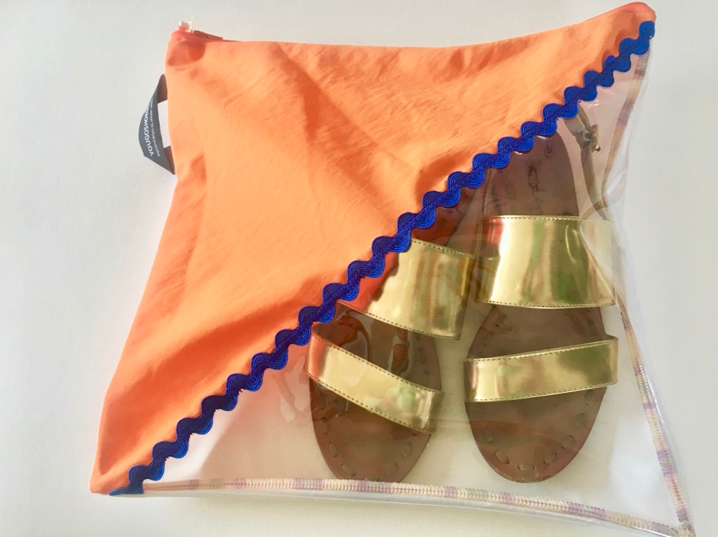 Orange and white pouch with a diagonal window and blue trim