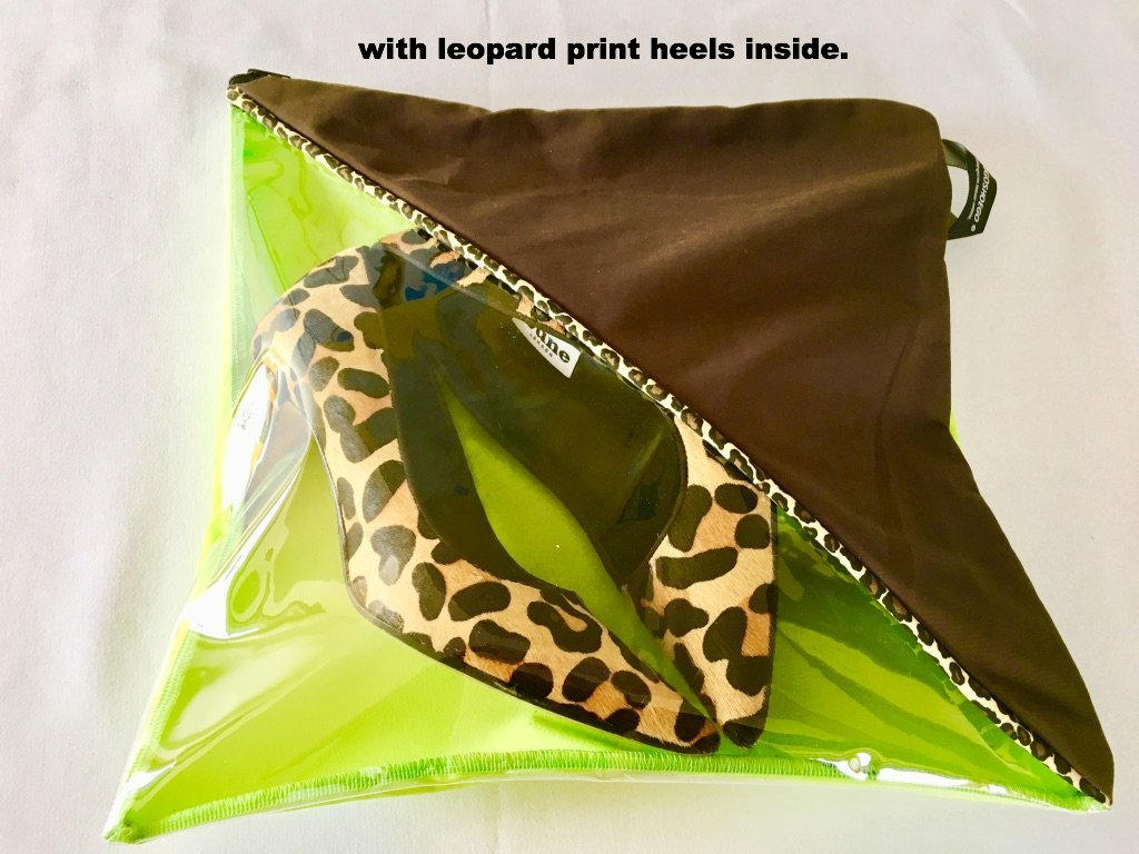 Lovely pouch in brown and green with a diagonal shape transparent window.