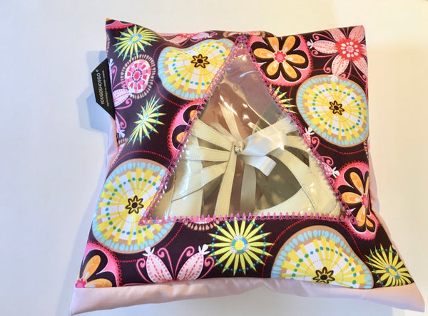 pretty patterned pouch in pink and brown with a triangular window.