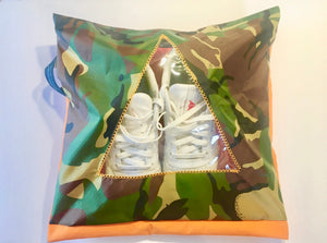 Jungle camouflage patterned shoe pouch with a triangular window.