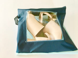 navy and light blue protective shoe pouch with a square window.