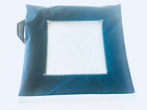 A small travel and storage pouch for shoes with a square transparent window