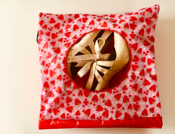 A pretty strawberry pattern graces this shoe pouch with a circular window!