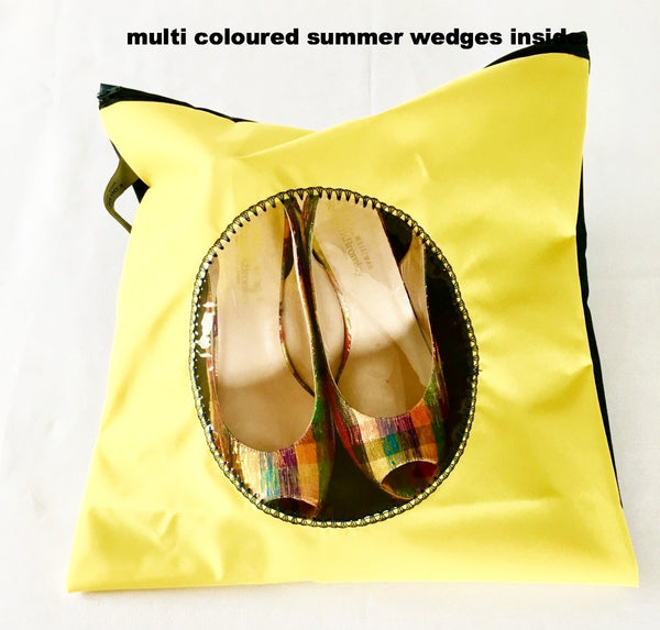 pretty shoe pouch in yellow and black with a circular transparent window.