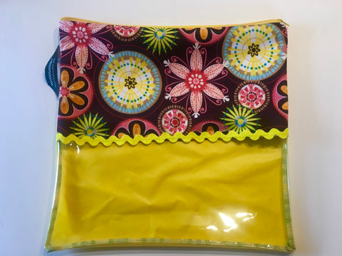 Patterned shoe pouch with a horizontal window.