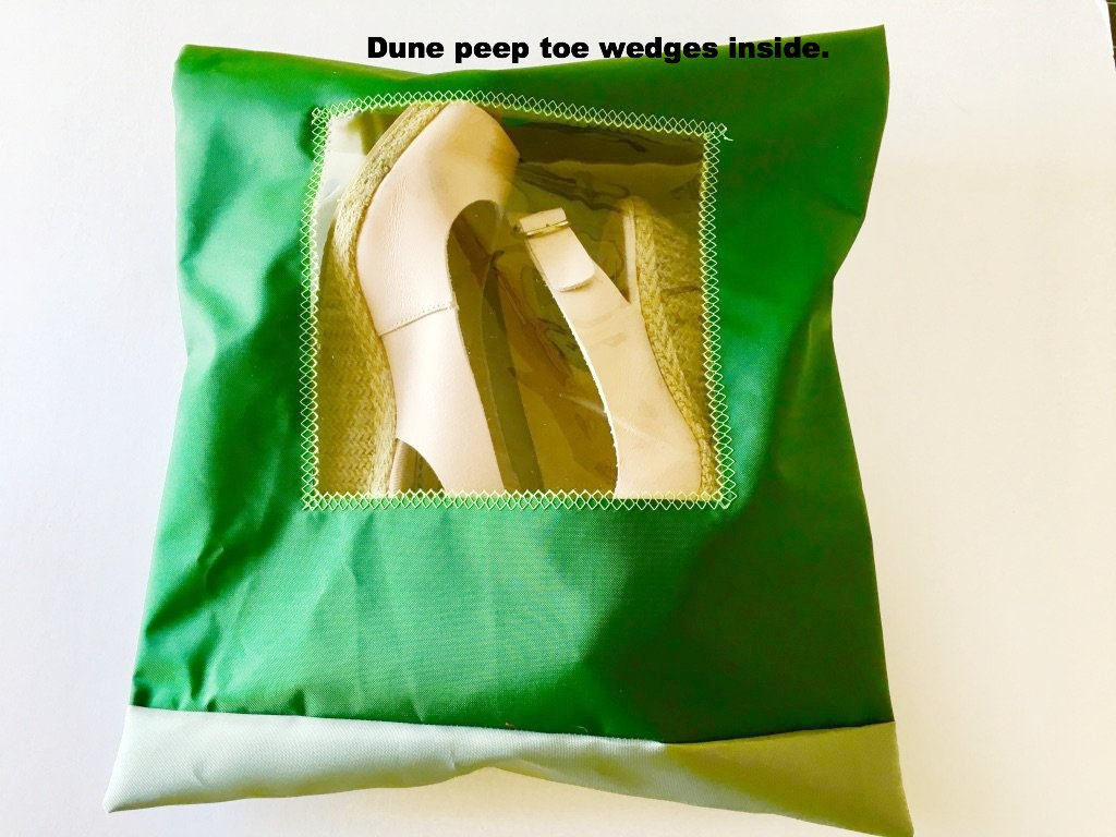 Lovely shoe pouch in dark and light green with a square transparent window.