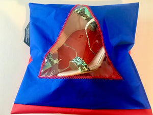Gorgeous royal blue and red shoe pouch with a triangular transparent window, hanging loop and zip closure.  Available in S,M,L .  Sizes correspond to shoe sizes.  Dual use as you can both store your shoes and pack for travel in Yougoshoego pouches!
