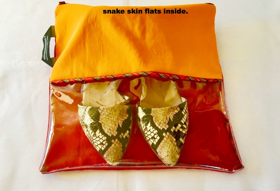 Gorgeous shoe pouch in orange and wine with a horizontal transparent window.