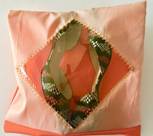 This pouch is apricot and orange with a diamond shaped transparent window