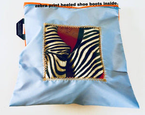 Pretty shoe pouch in pale blue and orange with a square transparent window.