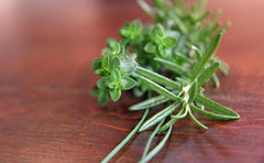Fresh Herbs on a wooden tabletop