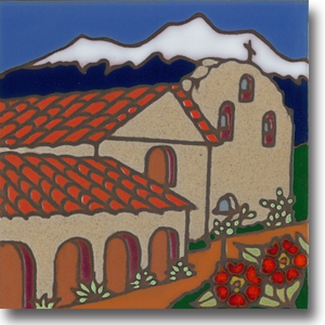Ceramic tile with original art image of Mission Santa Ines Virgen y Martir hand painted & kiln fired creating vivid, jewel-like colors. American made, hand crafted tile has a hardboard backing making it suitable as a trivet, original wall art or without the backing,  combine several to form a tile mosaic back splash.