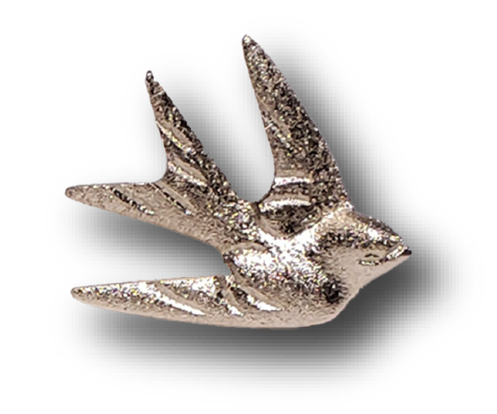 A brass Mission San Juan Capistrano Swallow in silver brass with a magnet. 2.5